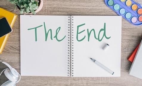 """handwritten """"The End"""" on notebook"""