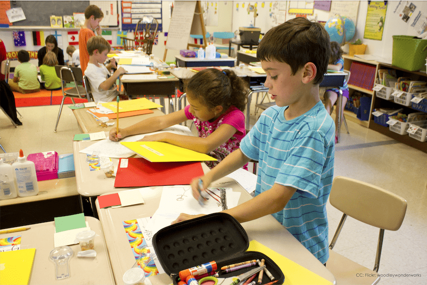 Cheerful and colorful classroom of children working